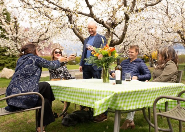 Group drinking wine at apple orchard